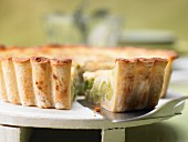 Spicy quiche with peas, thick beans, pine nuts and mint