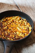 Fried potato and potato rosti in pan