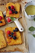 Sugar-free French toast with berries and banana and orange sauce