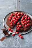 Sugar-free chocolate and date cake with fresh raspberries