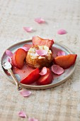 Baked almond cream dessert with rose and plum ragout
