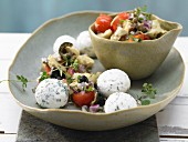 Small herb and cream cheese balls with marinated vegetables and oregano