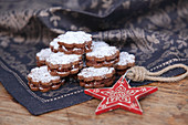 Chocolate biscuits filled with cream and dusted with icing sugar