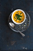 Pumpkin soup with chives and chopped pumpkins