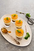 Passion fruit and cheesecake mousse in small glasses