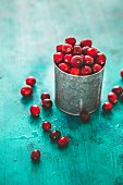 Fresh cranberries in a vintage metal pot