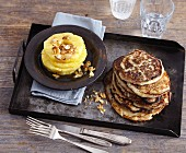 Vegan banana and coconut pancakes with almond-topped pineapple rings