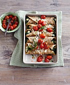 Crespelle au gratin filled with spinach and cherry tomatoes