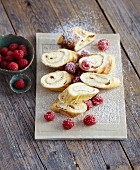Pancake rolls filled with lemon cream and raspberries