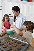 Mother and Children Baking Cookies