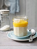 Warm porridge with coconut and mango purée (lactose-free)