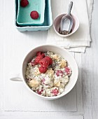 Millet and chia muesli with almond milk, raspberries and banana (lactose-free)