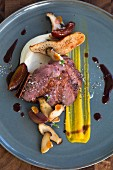 Duck breast with herbs, mushrooms and celery puree