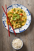 Chicken with coconut milk and rice