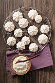 Meringue cookies on a cooling rack