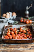 Fried tomatoes on a baking sheet