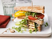 Club sandwiches with grilled vegetables and pesto cream