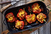 Stuffed peppers in a roasting tin (top view)