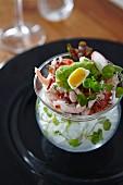 Shrimp salad with quail egg on ice