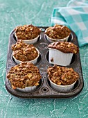 Apple and coconut muffins in a muffin tray