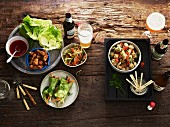 Various starters, salad and beer on a wooden table