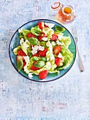 A summer salad with strawberries, goat's cheese and thyme honey