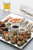 Grilled seafood with sauces