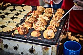 Stuffed Asian dough balls in a street kitchen
