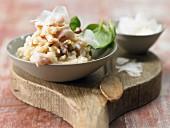 Risotto mit Calamari, getrockneten Tomaten und Basilikum