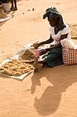 Woman trading farm crops