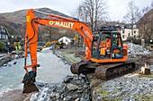 Diggers removing flood debris, UK