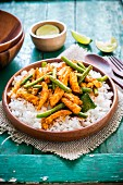 Spicy Thai chicken with green beans on rice