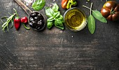 Vegetables, herbs and condiment: Greek black olives, fresh basil, sage, rosemary, tomato, peppers, oil