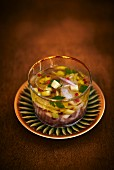 Ceviche in a marinade with pink pepper