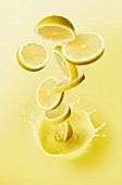 Lemon slices falling into lemon juice