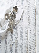 Old silver cutlery on a napkin