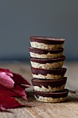Stack of healthy raw cashew butter chocolate cups