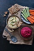 Hummus and beetroot hummus with crisp bread, carrots and celery