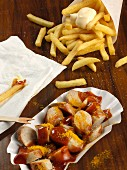 Currywurst and fries with mayonnaise