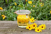 Homemade marigold oil in a jar