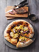 American pizza with sweetcorn, beef and BBQ sauce
