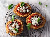 Low-carb cauliflower pizza with cooked ham and mushrooms