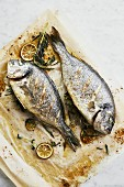 Oven-baked sea bream with lime and herbs