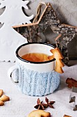 Shortbread Christmas cookies for cups, vintage cup of hot tea in knitted cup holder