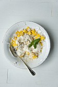 Muesli with oatmeal, coconut cream, dessicated coconut, mango and lemon balm