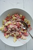 Muesli with oatmeal, melons, apples and yoghurt made from coconut milk