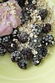 Muesli with oatmeal, frozen blackberries and yoghurt made from coconut milk