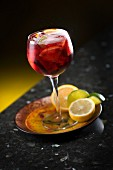 Sangria in a glass with citrus fruits