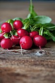Fresh radishes on the rustic wooden table