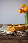 Lemon and olive oil cake on a white plate and rustic wooden table